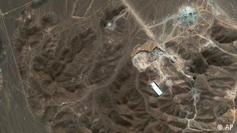 A suspected nuclear enrichment facility under construction inside a mountain located north of Qom, Iran.