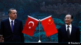 Source News Feed: EMEA Picture Service, Germany Picture Service Turkey's Prime Minister Recep Tayyip Erdogan (L) and Chinese Premier Wen Jiabao attend a signing ceremony at the Great Hall of the People in Beijing April 9, 2012. REUTERS/David Gray (CHINA - Tags: POLITICS)