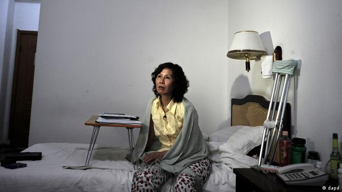 In this photo taken on June 30, 2010, Ni Yulan sits on the bed in a hotel in Beijing. The former lawyer and veteran activist left disabled by past police mistreatment, went on trial Thursday, Dec. 29, 2011, the third dissident in a week to be prosecuted as China presses a sweeping crackdown to deter popular uprisings like the ones that shook the Arab world. (AP Photo/Andy Wong)