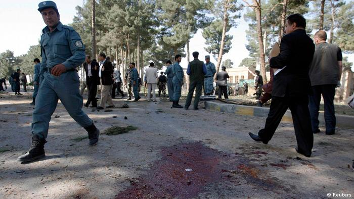 Afghan police arrive at the site of a suicide attack in Herat province