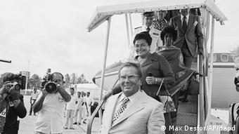 President Josip Broz Tito of Yugoslavia arrives at international airport on Friday, Aug. 13, 1976 in Colombo, Sri Lanka. Mrs. Jovanka Broz Tito follows her husband. Tito is first head of state who arrived to attend the 5th non-aligned nations summit conference which is scheduled to open Monday. (ddp images/AP Photo/Max Desfor)