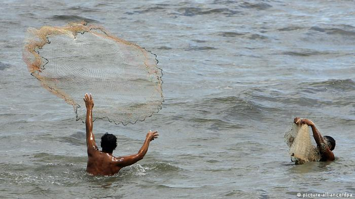 Fishermen cast their nets in Lake Managua in Nicaragua