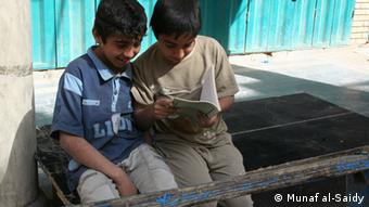 Children read a book along Mutanabbi Street