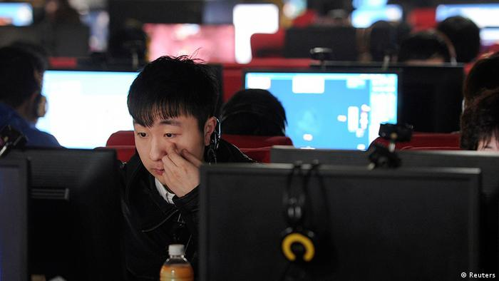 A man scratches his face as he uses a computer at an internet cafe in Hefei, Anhui province March 16, 2012. As of Friday, Beijing-based microbloggers were required to register on the Weibo platform using their real identities or face unspecified legal consequences, in a bid to curb what Communist officials call rumours, vulgarities and pornography. Many users, however, say the restrictions are clearly aimed at muzzling the often scathing, raucous - and perhaps most significantly, anonymous - online chatter in a country where the Internet offers a rare opportunity for open discussion. REUTERS/Stringer (CHINA - Tags: SCIENCE TECHNOLOGY POLITICS)