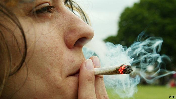 Woman smokes marijuana joint