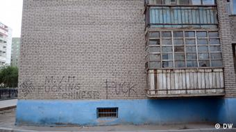 Racial slurs written on the side of a house in Mongolia