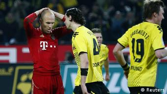 Arjen Robben of Bayern Munich reacts after missing the chance to score with a penalty against Borussia Dortmund