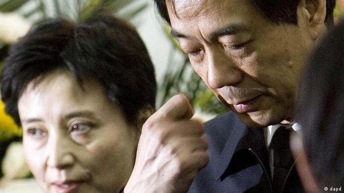 Gu Kailai (left) and husband Bo Xilai