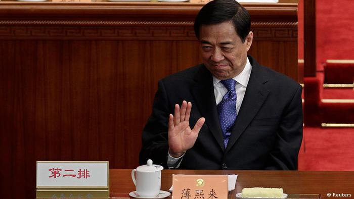 China's former Chongqing Municipality Communist Party Secretary Bo Xilai waves as he attends the opening ceremony of the Chinese People's Political Consultative Conference (CPPCC) at the Great Hall of the People in Beijing in this March 3, 2012 file photo. The wife of the former high-flying Communist Party chief of China's Chongqing city is suspected in the murder of British national Neil Heywood, Chinese state media reported on April 10, 2012. Former party chief in the city, Bo Xilai, has been suspended from top party bodies, state media said. REUTERS/Jason Lee/Files (CHINA - Tags: POLITICS CRIME LAW)