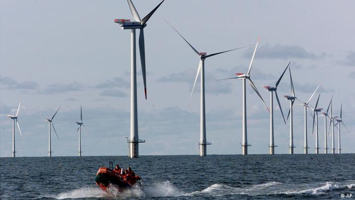 Offshore wind turbines with a small service vessel steering between them
