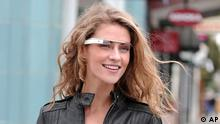 """In this undated handout photo provided by the Google[x] group's Project Glass, an early prototype of Google's futuristic Internet-connected glasses, are modeled. The specs are said to give you directions, let you video chat, shop and do everything else you now need a handheld gadget to accomplish. Google gave a glimpse of """"Project Glass"""" in a video and blog post this week. (Foto:Google/AP/dapd)"""