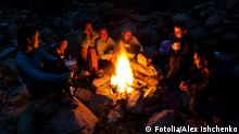 Group of backpackers relaxing near campfire after a hard day, tourist background. © Alex Ishchenko - Fotolia.com