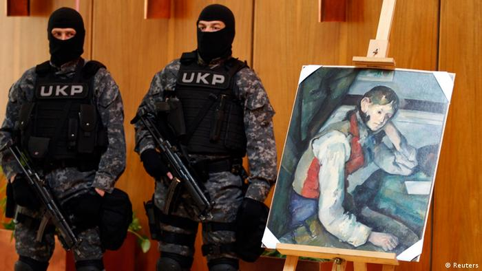 Serbian special police guard what is believed to be an impressionist masterpiece Boy in a Red Waistcoat by Paul Cezanne in Belgrade April 12, 2012. Police in Serbia believe they have recovered an Impressionist masterpiece by Paul Cezanne worth at least $109 million that was stolen at gunpoint in one of the world's biggest art heists four years ago, a police official said on Thursday. The canvas - Boy in a Red Waistcoat - was one of four paintings stolen from a Swiss art gallery in 2008 by a trio of masked robbers who burst in just before closing time and told staff to lay on the floor while they took what they wanted. REUTERS/Marko Djurica (SERBIA - Tags: CRIME LAW SOCIETY TPX IMAGES OF THE DAY)