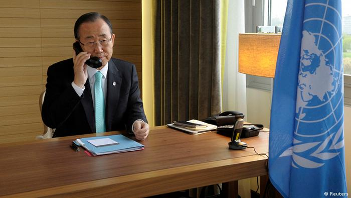 U.N. Secretary General Ban Ki-moon speaks with Special Joint Envoy to Syria Kofi Annan on the phone from his hotel room in Geneva in this April 12, 2012 handout.(Photo: REUTERS/UN Photo/Evan Schneider/Handout)