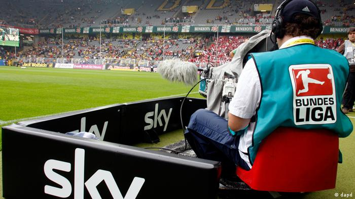 A cameraman for pay-TV station Sky Germany at work in Dortmund, before Borussia Dortmund's game against Cologne last season. (AP)