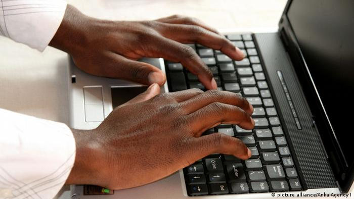 Image of hands at a computer