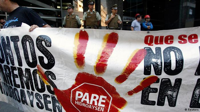 Environment supporters hold up a banner during a peaceful protest against a hydro-power dam project which will be built at the southern Chilean Patagonia, in Santiago March 14, 2012.The banner reads Stop Hidro-Aysen. REUTERS/Ivan Alvarado