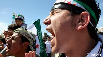 Syrian refugees and local residents take part in a demonstration against Syria's President Bashar al-Assad, after Friday prayers outside the Syrian embassy in Amman April 13 2012.