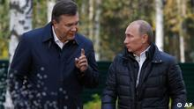 Russian Prime Minister Vladimir Putin, right, listens to Ukranian President Viktor Yanukovich as they walk at the presidential residence in Zavidovo, about 90 miles (150 kilometers) north of Moscow, Russia. Russia's dominant political party on Saturday nominated Vladimir Putin for president, almost certainly ensuring his return to the office he held for eight years, and approved Putin's proposal that current president Dmitry Medvedev swap places and become prime minister. (ddp images/AP Photo/Sergei Karpukhin, pool)
