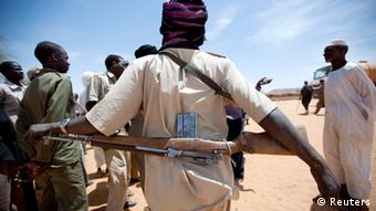 A member of the rebel movement Sudan Liberation Army (SLA) - Abdul Wahid, escorts the delivery of 30,000 litres of water delivered by the African Union - United Nations Mission in Darfur's (UNAMID) peacekeeping troops from South Africa, in Forog, some 45km (28 miles) north of Kutum March 28, 2012.