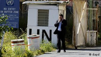 A man crosses the U.N.-controlled buffer zone towards Turkish Cypriot part of Nicosia
