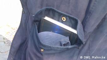 A copy of the Koran in a coat pocket