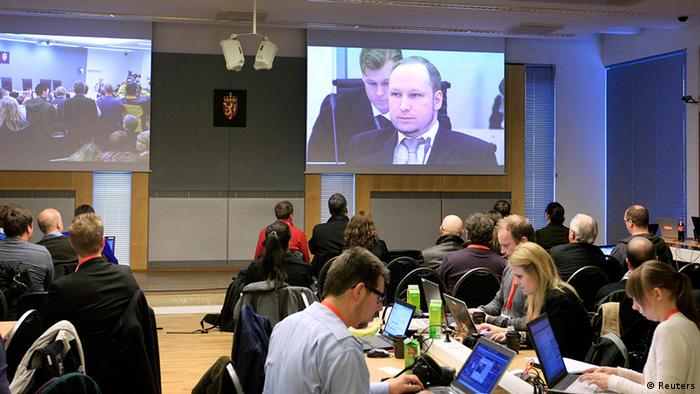 An image of Norwegian mass killer Anders Behring Breivik is projected onto a screen in the press room, where journalists without access to the courtroom followed proceedings on large projector screens, during his terrorism and murder trial in Oslo April 16, 2012. Breivik, who massacred 77 people last summer, arrived under heavy armed guard at an Oslo courthouse on Monday, lifting his arm in what he has called a rightist salute as his trial began. Breivik, 33, has admitted setting off a car bomb that killed eight people at government headquarters in Oslo last July, then massacring 69 in a shooting spree at an island summer camp for Labour Party youths. REUTERS/Lise Aserud/Scanpix Norway (NORWAY - Tags: CRIME LAW) NO COMMERCIAL OR BOOK SALES. THIS IMAGE HAS BEEN SUPPLIED BY A THIRD PARTY. IT IS DISTRIBUTED, EXACTLY AS RECEIVED BY REUTERS, AS A SERVICE TO CLIENTS. NORWAY OUT. NO COMMERCIAL OR EDITORIAL SALES IN NORWAY