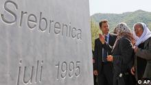 Chief Prosecutor of the International Criminal Tribunal for the former Yugoslavia Serge Brammertz , talks with members of Union of Women from Srebrenica during his visit to the Srebrenica-Potocari Memorial and Cemetery, in Srebrenica, Bosnia, 75 kms east of the capital, Sarajevo, dedicated to victims of the 1995 genocide, Tuesday, April 27, 2010. (AP Photo/Amel Emric)