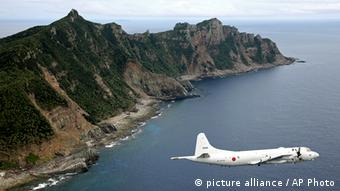 Japan Maritime Self-Defense Force's P-3C Orion surveillance plane flies over the disputed islands in the East China Sea. Photo:Kyodo News, File/AP/dapd