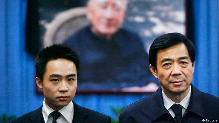 China's former Chongqing Municipality Communist Party Secretary Bo Xilai (R) and his son Bo Guagua stand in front of a picture of his father Bo Yibo, former vice-chairman of the Central Advisory Commission of the Communist Party of China, at a mourning hall in Beijing in this January 18, 2007 file photo. Bo Guagua, a 24-year-old descendant of Chinese Communist royalty, seemed destined to one day become a rich and powerful businessman in an economy that in his lifetime would become the world's largest. His pedigree, elite schooling, easy confidence and connections left those who knew him in no doubt he would pursue a business career and amass a fortune. That was until a British expatriate, Neil Heywood, died in November 2011 in a hotel in a huge city in western China, a world away from the clipped lawns and hushed libraries of Harvard University where Bo was studying. The story now looks certain to ruin his family and upend his ambitions. REUTERS/Stringer (CHINA - Tags: POLITICS CRIME LAW TPX IMAGES OF THE DAY) CHINA OUT. NO COMMERCIAL OR EDITORIAL SALES IN CHINA