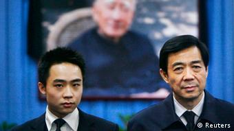 China's former Chongqing Municipality Communist Party Secretary Bo Xilai (R) and his son Bo Guagua stand in front of a picture of his father Bo Yibo, former vice chairman of the Central Advisory Commission of the Communist Party of China, at a mourning hall in Beijing