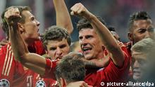 Munich's Mario Gomez (C) celebrates his 2-1 goal during the Champions League semi final first leg soccer match between FC Bayern Munich and Real Madrid at the Allianz Arena in Munich, Germany, 17 April 2012. Photo: Marc Mueller dpa/lby