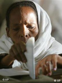 An Ethiopian woman casts her vote at a polling station in Addis Ababa, Ethiopia Sunday, May 15, 2005 during the third democratic elections in Ethiopia's 3,000-year history. (AP Photo/Karel Prinsloo)