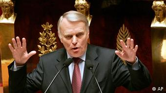 Opposition Socialist Party leader in the French National Assembly, Jean-Marc Ayrault, gestures as he speaks during a debate at the French National Assembly in Paris, Tuesday, April 1, 2008. The French prime minister Francois Fillon said Tuesday that his country could contribute several hundred more troops to reinforce the fight against the Taliban and their al-Qaida allies in Afghanistan. (AP Photo/Francois Mori)