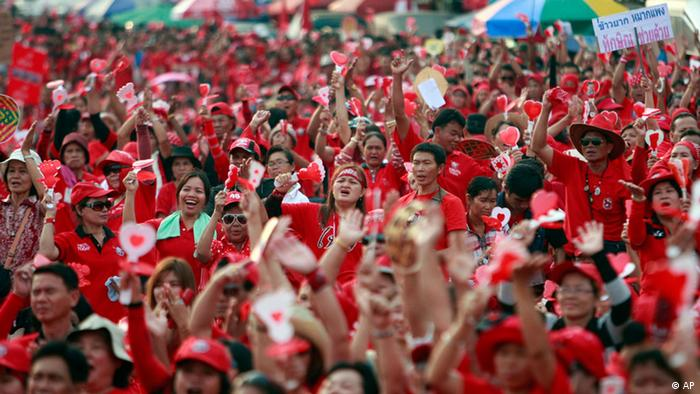 Red Shirts protesters react during a rally at the Democracy Monument
