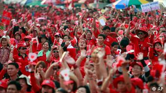 Red Shirts protesters react during a rally at the Democracy Monument Saturday, March 12, 2011 in Bangkok, Thailand.