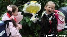 School girls with flowers at a school in Moscow on September the 1st, 2010. Photo Andrey Rudakov
