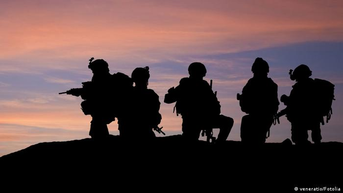 #34163693Silhouette of modern troops in Middle East silhouette © veneratio #34163693
