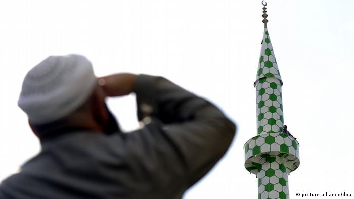 A Muslim gazing at the new minaret at a Hamburg mosque