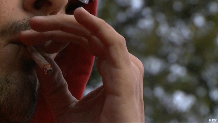 Cannabis: a young man smoking pot