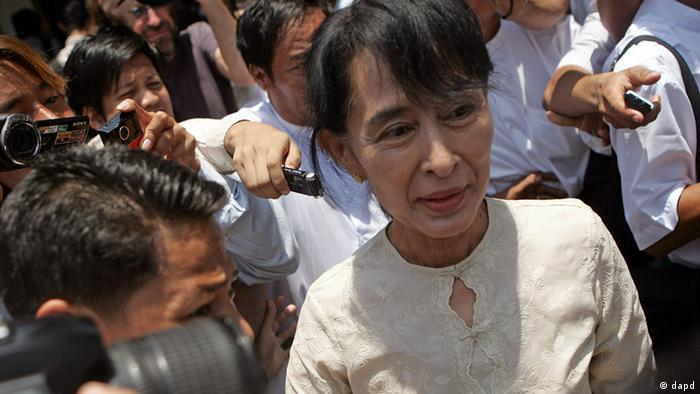 Aung San Suu Kyi leaves a meeting at the NLD's headquarters