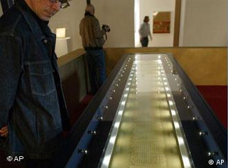The 2,120-year-old scroll is heavily guarded and protected against light