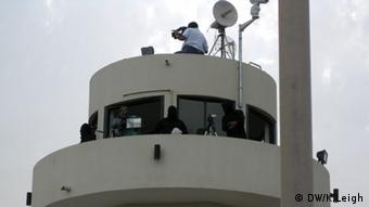 Masked government media staffers film the protests