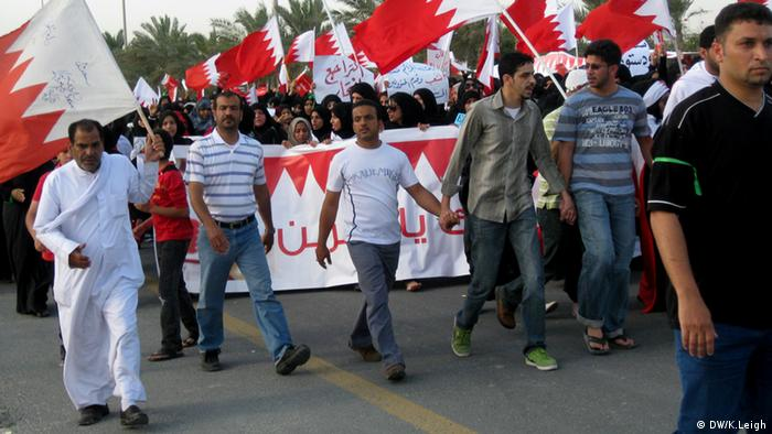 Protesters march in the hard-hit Shi'a neighborhood of Sitra