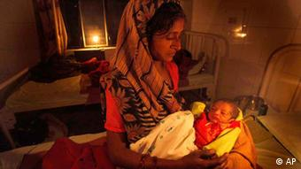An Indian mother tends to her new born baby