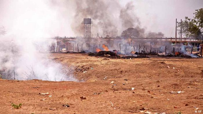 This photo of Saturday, April 14, 2012, allegedly shows the aftermath of a bombing by the Sudanese Air Force in Bentiu, South Sudan . Two Sukhoi jet fighters dropped 6 bombs in the area, killing 5 and wounding 4 others.
