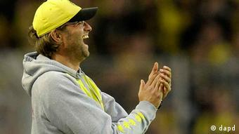 Dortmund head happy coach Juergen Klopp reacts during the German first division Bundesliga soccer match between Borussia Dortmund an VfL Wolfsburg in Dortmund, Germany, Saturday, Nov. 5, 2011. (Foto:Martin Meissner/AP/dapd) - NO MOBILE USE UNTIL 2 HOURS AFTER THE MATCH, WEBSITE USERS ARE OBLIGED TO COMPLY WITH DFL-RESTRICTIONS, SEE INSTRUCTIONS FOR DETAILS -