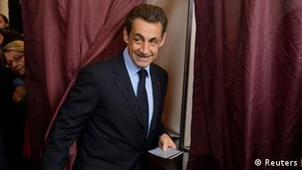 Sarkozy exiting a voting booth