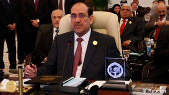 Iraqi Prime Minister Nuri al-Maliki attends the opening session of the 23rd Arab League summit in Baghdad March 29, 2012. REUTERS/Saad Shalash (IRAQ - Tags: POLITICS)