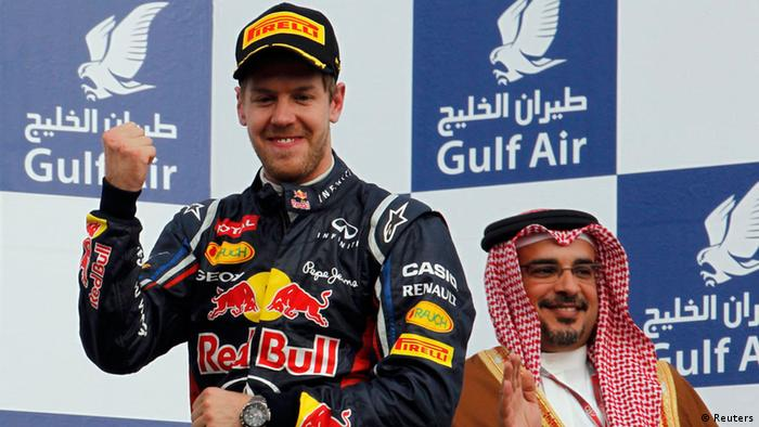 Red Bull Formula One driver Sebastian Vettel of Germany punches the air after winning the Bahrain F1 Grand Prix at the Sakhir circuit in Manama April 22, 2012. REUTERS/Steve Crisp (BAHRAIN - Tags: SPORT MOTORSPORT)